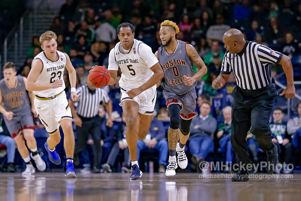 SOUTH BEND, IN - JANUARY 12: D.J. Harvey #5 of the Notre Dame Fighting Irish brings the ball up court during the game against the Boston College Eagles at Purcell Pavilion on January 12, 2019 in South Bend, Indiana. (Photo by Michael Hickey/Getty Images) *** Local Caption *** D.J. Harvey