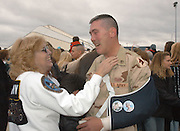 Jean Mattingly greets her son, Staff Sgt. Russell Mattingly, 35, of Loretto, Ky., as he returns from Iraq Saturday, Jan. 21, 2006 with other members of the Kentucky National Guard's Battery B, 1st Battalion, 623rd Field Artillery to the Kentucky Air National Guard Base in Louisville, Ky. Mattingly broke his arm when he slipped on the ice getting off the plane in New Jersey on his way home. Two other soldiers from the battery, Sgt. Jonathan Adams Hughes and Sgt. Ryan Montgomery, died from roadside bombs in separate combat incidents. (AP Photo/Brian Bohannon).