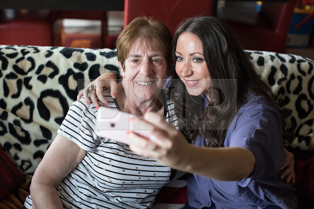 © Licensed to London News Pictures . 06/07/2017 . Manchester , UK . Unprompted , BARBARA DRANSFIELD and PAULA WILLIAMSON pose together for a selfie , initiated by Williamson . Artwork by convicted criminal  Charles Salvador (previously Charles Bronson) has been sold on behalf of Salvador to raise a £1,000 to support Barbara and Len Dransfield . Barbara , who has become friendly with Salvador , was brought the money and a card by Salvador's fiance , Paula Wiliamson . Barbara Dransfield was brutally assaulted by masked robbers as she sat at home in her wheelchair . She suffered extensive injuries to her face and body . Photo credit : Joel Goodman/LNP