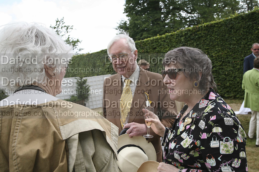 Mr. and Mrs. William Rees-Mogg. Cartier Style et Luxe champagne reception and lunch at the  the Goodwood festival of Speed. 9 July 2006. -DO NOT ARCHIVE-© Copyright Photograph by Dafydd Jones 66 Stockwell Park Rd. London SW9 0DA Tel 020 7733 0108 www.dafjones.com