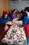 Woman age 62 served Christmas dinner in church soup kitchen.  Minneapolis Minnesota USA