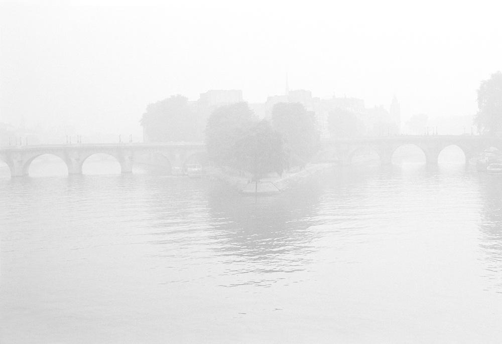 View of the Ile de la Cité in the fog, Paris from the post dês Artes. Black and white photo