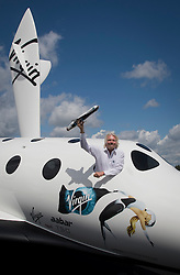 © London News Pictures. 11/07/2012. Farnborough, UK. Sir Richard Branson posing during a photocall at Farnborough Airshow for the UK unveiling of new Virgin Galactic aircraft and spacecraft products on July 11, 2012.  FIA is a seven-day international trade fair for the aerospace industry which is held every two years at Farnborough Airport . Photo credit: Ben Cawthra/LNP.