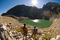 A young couple enjoys the view from Timberline Lake in Grand Teton National Park, Jackson Hole, Wyoming.