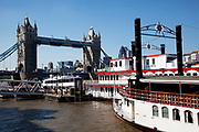 Paddle steamer boats moored near to Tower Bridge, London.