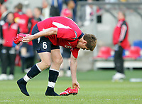 Fotball / Football<br /> Privatlandskamp / Friendly match<br /> Norge v Sør-Korea 0-0<br /> Norway v Korea Republic 0-0<br /> 01.06.2006<br /> Foto: Morten Olsen, Digitalsport<br /> <br /> John Arne Riise takes of his booths after the match to give them away to a young fan