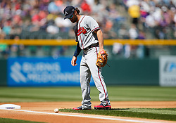 April 8, 2018 - Denver, CO, U.S. - DENVER, CO - APRIL 08: Atlanta Braves Infielder Charlie Culberson (16) watches a slow ground ball as it stays fair during a regular season MLB game between the Colorado Rockies and the visiting Atlanta Braves on April 8, 2018 at Coors Field in Denver, CO. (Photo by Russell Lansford/Icon Sportswire) (Credit Image: © Russell Lansford/Icon SMI via ZUMA Press)