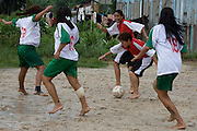 A tackle during the all women's football match in Jardim São Marcos favela, Cubatão