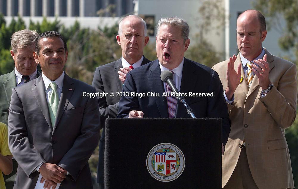 Former U.S. Vice President and Nobel laureate Al Gore, center, speaks in a press conference in front of the Los Angeles Department of Water building on Friday March 22, 2013, as  Los Angeles Mayor Antonia Villaraigosa, left, announces the city plans to become the largest coal-free city in the country by shifting the Los Angeles Department of Water and Power off ?dirty? coal and replacing it with renewable energy sources and natural gas. LADWP currently gets 70 percent of its energy from coal plants. Gore included Los Angeles among the top five cities in the world ``where combating global warming is concerned.'' Only the cities of London, Toronto, Copenhagen and Berlin have ``tried to do something like this,'' he said, adding that Los Angeles would be the first American city to become coal-free.(Photo by Ringo Chiu/PHOTOFORMULA.com).