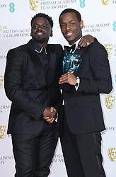 Daniel Kaluuya (left) hugs Micheal Ward after presenting him with the EE Rising Star Award at the 73rd British Academy Film Awards held at the Royal Albert Hall, London.. Photo credit should read: Doug Peters/EMPICS