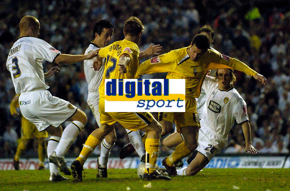 Photo: Jed Wee.<br /> Leeds United v Preston North End. Coca Cola Championship. Play-off, First Leg. 05/05/2006. <br /> <br /> Preston's David Nugent (R) fires home in a crowded penalty area to finish off an excellent run.