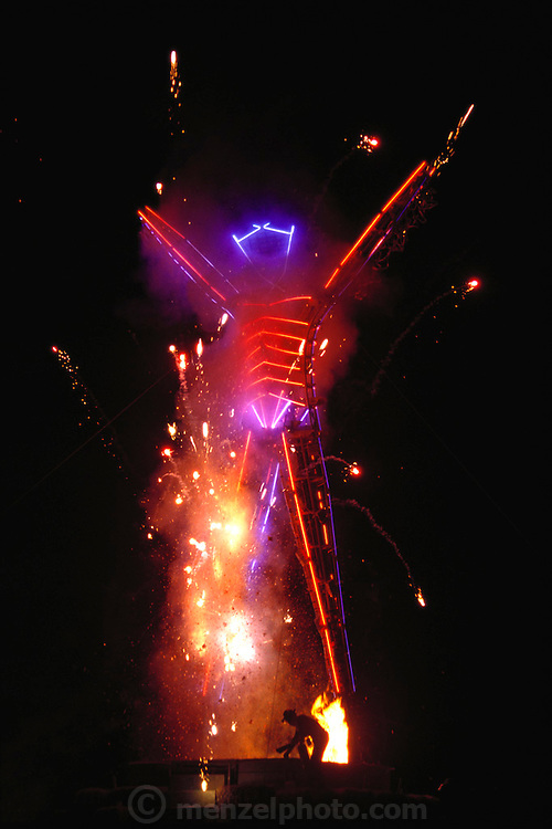 The initial lighting of the Burning Man begins with fireworks during the last all-night party. Burning Man is a performance art festival known for art, drugs and sex. It takes place annually in the Black Rock Desert near Gerlach, Nevada, USA.