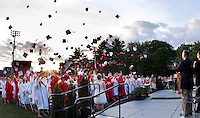 The Laconia High School 2011 graduating class toss their mortar boards in the air following the 133rd commencement celebration Friday evening.  (Karen Bobotas/for the Laconia Daily Sun)