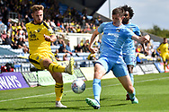 Oxford United midfielder James Henry (17)  gets a cross in under pressure during the EFL Sky Bet League 1 match between Oxford United and Coventry City at the Kassam Stadium, Oxford, England on 9 September 2018.