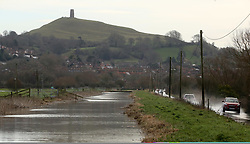 © London News Pictures. 26/12/2017. Glastonbury, UK.  Traffic drives through surface water where the River Blue has broken it's banks at Glastonbury on Boxing Day morning. Photo credit: Jason Bryant/LNP