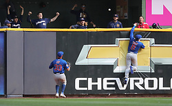 September 23, 2017 - Milwaukee, WI, USA - Chicago Cubs center fielder Ian Happ (8) is unable to catch the game-winning, two-run home run ball hit by Milwaukee Brewers batter Travis Shaw in the 10th inning on Saturday, Sept. 23, 2017 at Miller Park in Milwaukee, Wis. (Credit Image: © Chris Sweda/TNS via ZUMA Wire)