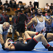 Donna North's Marcos Gonzalez reacts after pinning Rio Grande City's Victor Canales, III in the boys 138-pound championship match during the District 16-5A Wrestling Tournament Thursday, February 8, 2018, in La Grulla. photo by Nathan Lambrecht/The Monitor