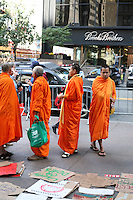 Monks visit the Occupy Wall Street protest at Zuccotti Park in the financial district New York