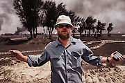 Author Tim Cahill in the South Al-Burgan Oil field, Kuwait. More than 700 wells were set ablaze by retreating Iraqi troops creating the largest man-made environmental disaster in history..
