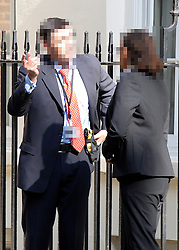 NOTE TO EDITORS parts of image pixellated to protect identity. © Licensed to London News Pictures. 14/06/2012. London, UK. A Police officer is seen wearing a taser underneath his suit jacket on Downing Street today 14th June 2012. Photo credit : Stephen Simpson/LNP