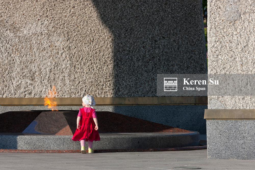Child in in Vicotry Square, Vitebsk, Belarus