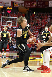 14 February 2015:   Ron Baker digs in as he heads past the 3 point arc and finds DeVaughn Akoon-Purcell during an NCAA MVC (Missouri Valley Conference) men's basketball game between the Wichita State Shockers and the Illinois State Redbirds at Redbird Arena in Normal Illinois