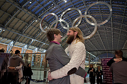 © Licensed to London News Pictures. 19/01/2012. London, U.K. Sanderson Jones and Mikey Lear take part in  world's Longest marathon hug attempt at St. Pancras station, London on January 19th, 2012. Competitors are attempting to break the Guinness World Record for the world's Longest hug. Photo credit : Rich Bowen/LNP