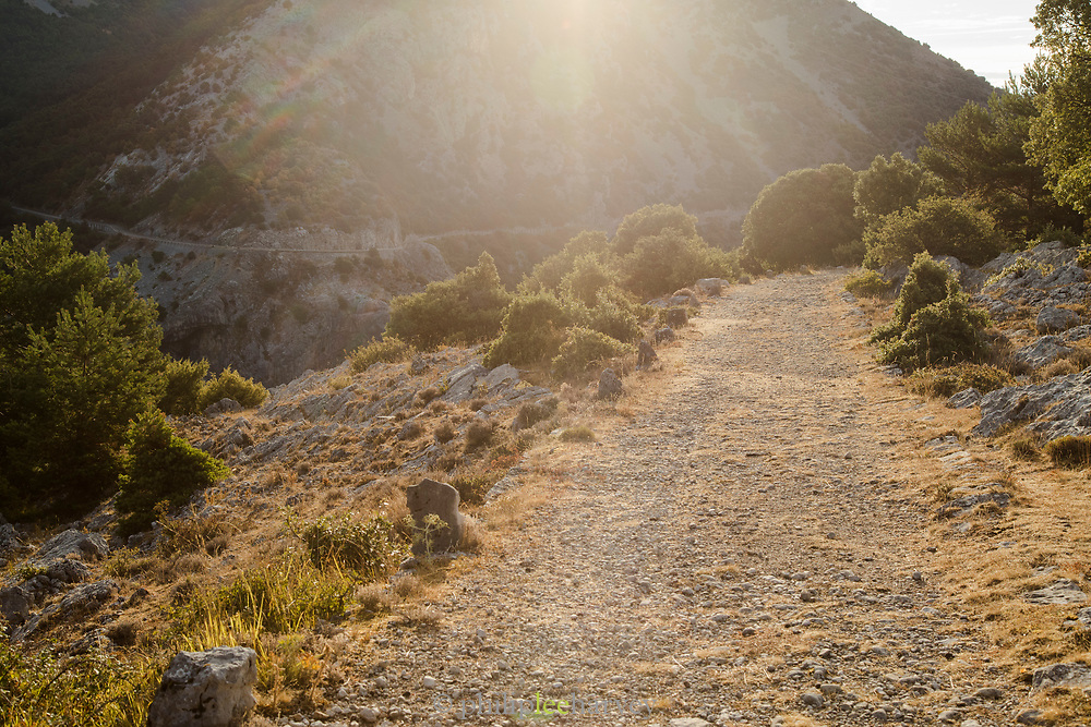 Old stone road ahead on Route Napoleon in mountain, Seranon, France
