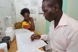 ..... consults with a patient at the MMS clinic on the ANC day. SAHFA baseline survey visit to Angiya, Homa Bay County, Kenya.  SAHFA Kenya © April 2019