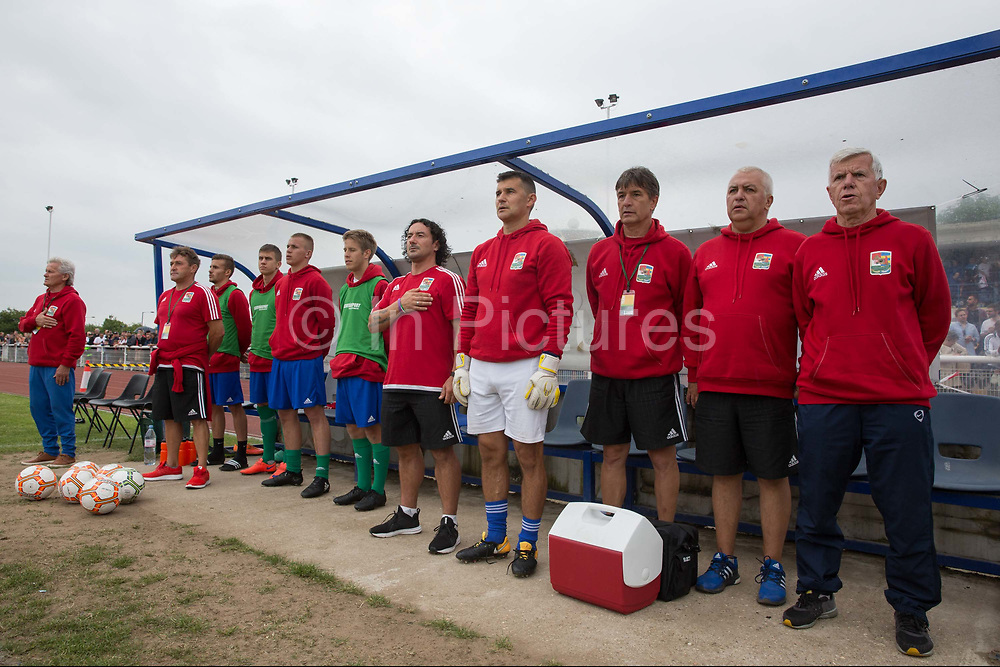 Karpatalya during national anthem. Karpatalya (RED) beat Northern Cyprus (WHITE) 3 -2 in penalties during the Conifa Paddy Power World Football Cup finals on the 9th June 2018 at Queen Elizabeth II Stadium in Enfield Town in the United Kingdom. Team mates from the Turkish Republic of Northern Cyprus  take on the Hungarians in Ukraine for the CONIFA World Football Cup final. CONIFA is an international football tournament organised by CONIFA, an umbrella association for states, minorities, stateless peoples and regions unaffiliated with FIFA. (photo by Sam Mellish / In Pictures via Getty Images)
