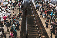 People crowd the platforms on either side of  arailroad track at Fort railway station in Colombo, Sri Lanka. (April 1, 2017)