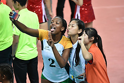 GUANGZHOU, June 20, 2017  Mosia Manana (L Front) of South Africa takes photos with volunteers after the women's volleyball match against China at 2017 BRICS Games in Guangzhou, south China's Guangdong Province, June 20, 2017. (Credit Image: © Liang Xu/Xinhua via ZUMA Wire)