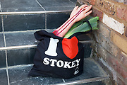 "I love Stokey bag with a joke severed arm. Stoke Newington Zombie-a-thon. Hundreds of people joined together in protest in North London to demonstrate against the planned opening of a large Sainsbury's supermarket. Dressed up as zombies the protesters were making the point that they should keep local shops in the area and not have the high street ruined by large chains. The action by Stokey Local says: ""In Stoke Newington, even the dead are rising up to say 'no' to a proposed Sainsbury's development."" Walking slowly as if in a zombie film the march culminated in passing a Sainsbury's Local supermarket on the High Street. In the middle of June it was announced that a development is being planned for Wilmer Place, just beside Abney Park Cemetery on the corner of Church Street and the High Street – right in the heart of Stoke Newington. The proposed development comprises a large Sainsbury's supermarket and 44 homes and has significant implications for the diversity of the local economy, local employment, transport & traffic, noise and safety and local heritage."