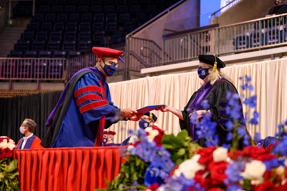 New graduates of the Dedman School of Law attend graduation, Saturday, May 15, 2021 in Moody Coliseum on the SMU Campus.