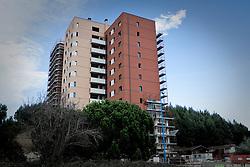 Potenza (PZ), 23-11-2010 ITALY - Il quartiere Bucaletto. Bucaletto è un quartiere popolare della periferia est di Potenza. Fu progettato all'indomani del terremoto dell'Irpinia del 23 novembre 1980, per risolvere i problemi delle famiglie sfollate a causa dei crolli di alcune abitazioni della città, difatti è caratterizzato dalla presenza di abitazioni singole, in prefabbricati..Nella Foto: Le torri di edilizia popolare e privata che comprendono alcuni appartamenti che saranno venduti a basso costo ai residenti del quartiere.