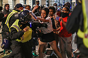 A protestor scuffle with police during late-night clashes with police in central London on Wednesday, June 3, 2020. (Photo/ Vudi Xhymshiti)