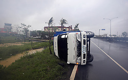 PINGTUNG, Sept. 14, 2016 (Xinhua) -- A truck is blown down by strong wind in typhoon-hit Taiwan, southeast China, Sept. 14, 2016. Typhoon Meranti on Wednesday brought strong winds and heavy downpour to the island. (Xinhua) (ry) (Credit Image: © Johnson Liu/Xinhua via ZUMA Wire)