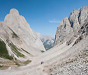 Hike the Mount Edith loop trail (8 miles) over Cory Pass near the pinnacle of Mount Louis, in Banff National Park, Alberta, Canada. This is part of the big Canadian Rocky Mountain Parks World Heritage Site declared by UNESCO in 1984. Stitched from 3 overlapping images.