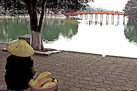 """Baguettes at Hoan Kiem Lake or """"Lake of the Returned Sword"""" is located in the historical center of Hanoi, the capital of Vietnam. The lake is one of the major scenic spots in the city and serves as a focal point for its public life."""