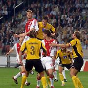 NLD/Amsterdam/20060928 - Voetbal, Uefa Cup voorronde 2006, Ajax - IK Start, kopbal van markus Rosenberg en springt boven de verdediging