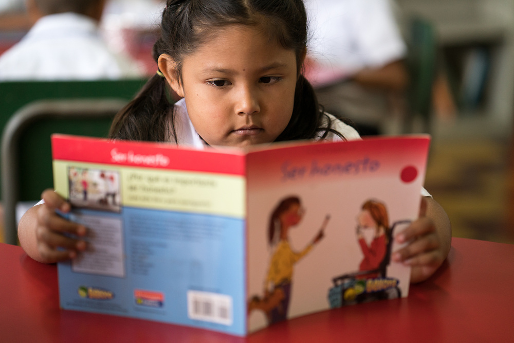 Children take a set time out during school to read on the grounds of Miguel Paz Barahona Elementary School in Corquin, Copan, Honduras, Feb. 13, 2018. Central American Medical Outreach operates a Literacy programs throughout Honduras to help further education for children. Photo Ken Cedeno