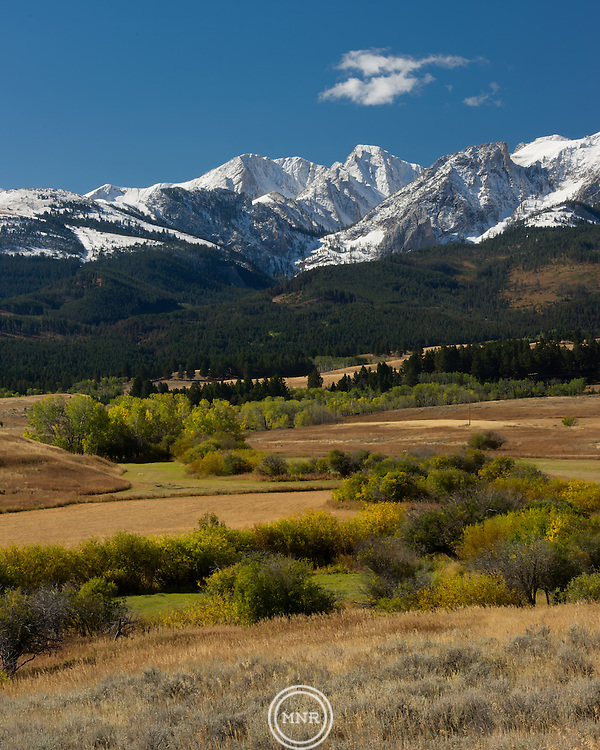 The Bridger Mountains covered in an early fall snow.