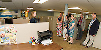 Document Department Supervisor Jessica Davis give town of Moultonboro employees a walk though tour of the CruCon facility during Saturday evenings VIP Pre Opening.  (Karen Bobotas/for the Laconia Daily Sun)