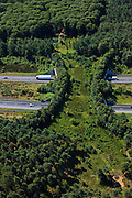Nederland, Gelderland, Gemeente Barneveld, 30-06-2011; Veluwe met A1 en ecoduct Kootwijk.Highway A1 through nature area the Veluwe, the Netherlands. Ecoduct (wildlife bridge) crossing the highway..luchtfoto (toeslag), aerial photo (additional fee required).copyright foto/photo Siebe Swart