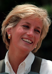 DIANA IN ANGOLA: Diana, Princess of Wales, laughs during her visit to a minefield at Huambo in Angola. The Princess pressed the trigger to detonate one of the landmines.