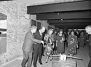 24/08/1984<br /> 08/24/1984<br /> 24 August 1984<br /> Opening of ROSC '84 at the Guinness Store House, Dublin. Mr Pat Murphy, ROSC Chairman, gives a description of one of the art exhibits to President Patrick Hillery and Maeve Hillery.