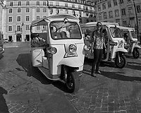 Tut-Tut Drivers. Street Photography in Lisbon. Image taken with a Nikon D850 camera and 8-15 mm fisheye lens.