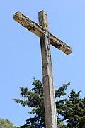 Stone cross at the top of Cerro de la Cruz above Antigua.  Antigua Guatemala, Republic of Guatemala. 02Mar14