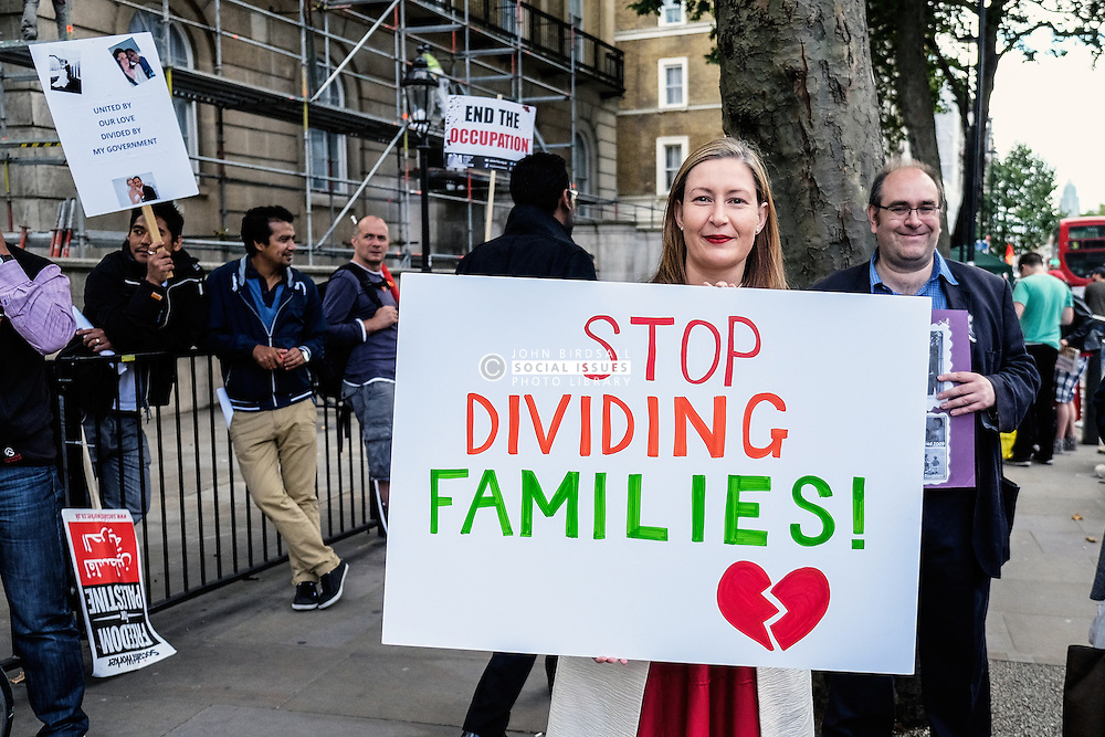 Demonstrators protesting against government rules on family migration. UK Aug 2014