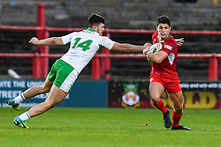 11th November 2018 , Racecourse Ground,  Wrexham, Wales ;  Rugby League World Cup Qualifier,Wales v Ireland ; Josh Ralph of Wales evades the tackle of James Bentley of Ireland <br /> <br /> <br /> Credit:   Craig Thomas/Replay Images